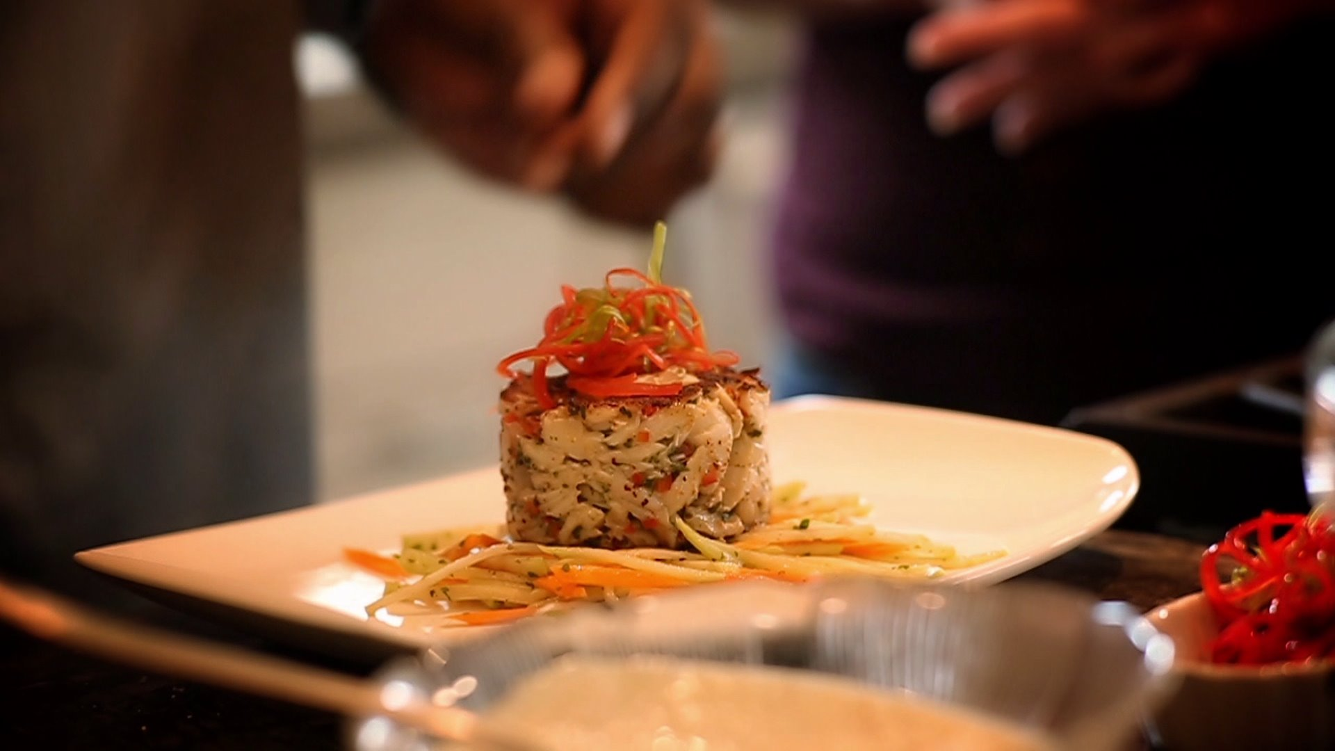 Seared Crab Cakes Over Mirliton Slaw