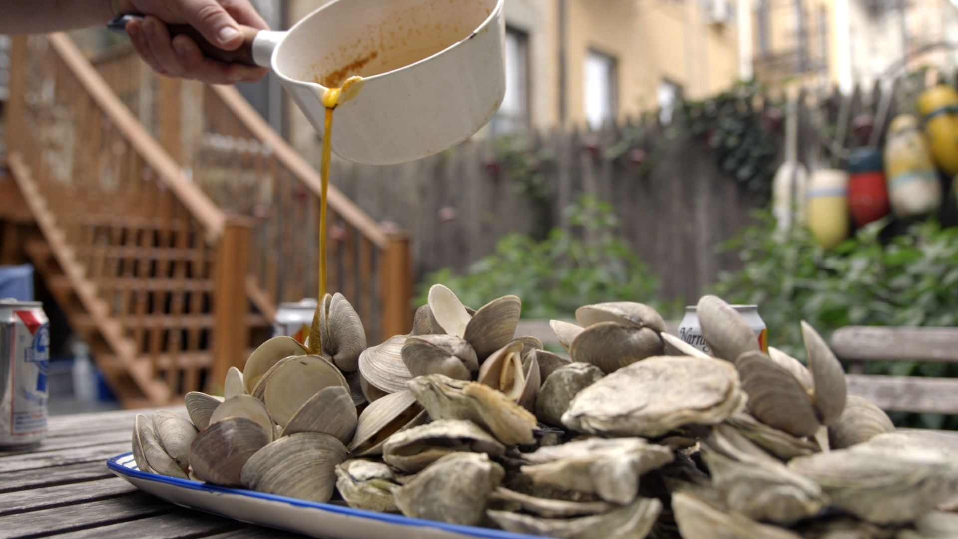 GQ's Guide to the Perfect Seafood BBQ: Oysters and Clams with Garlic Butter