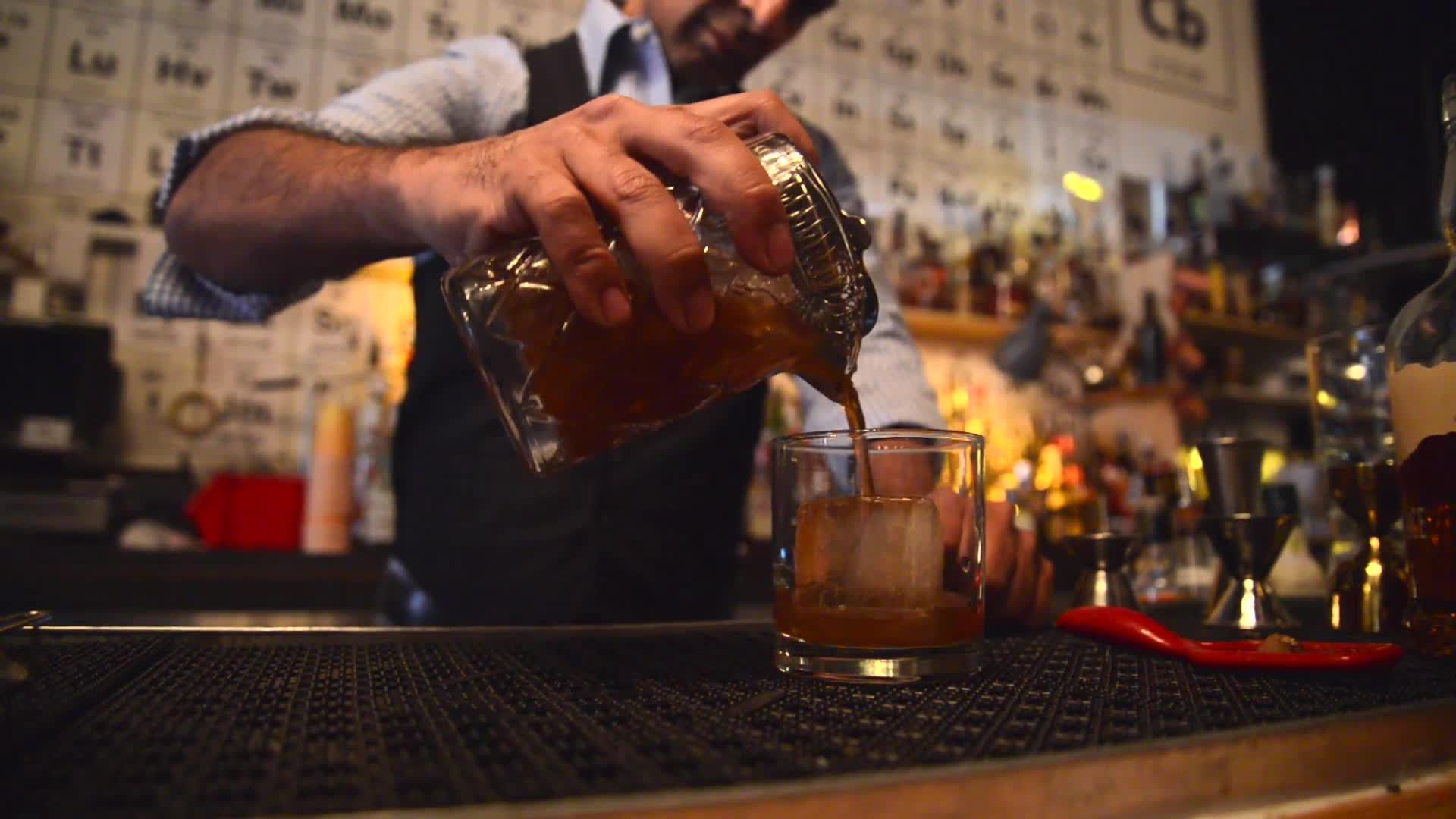 Making a Fireside Old Fashioned at the Collins Bar