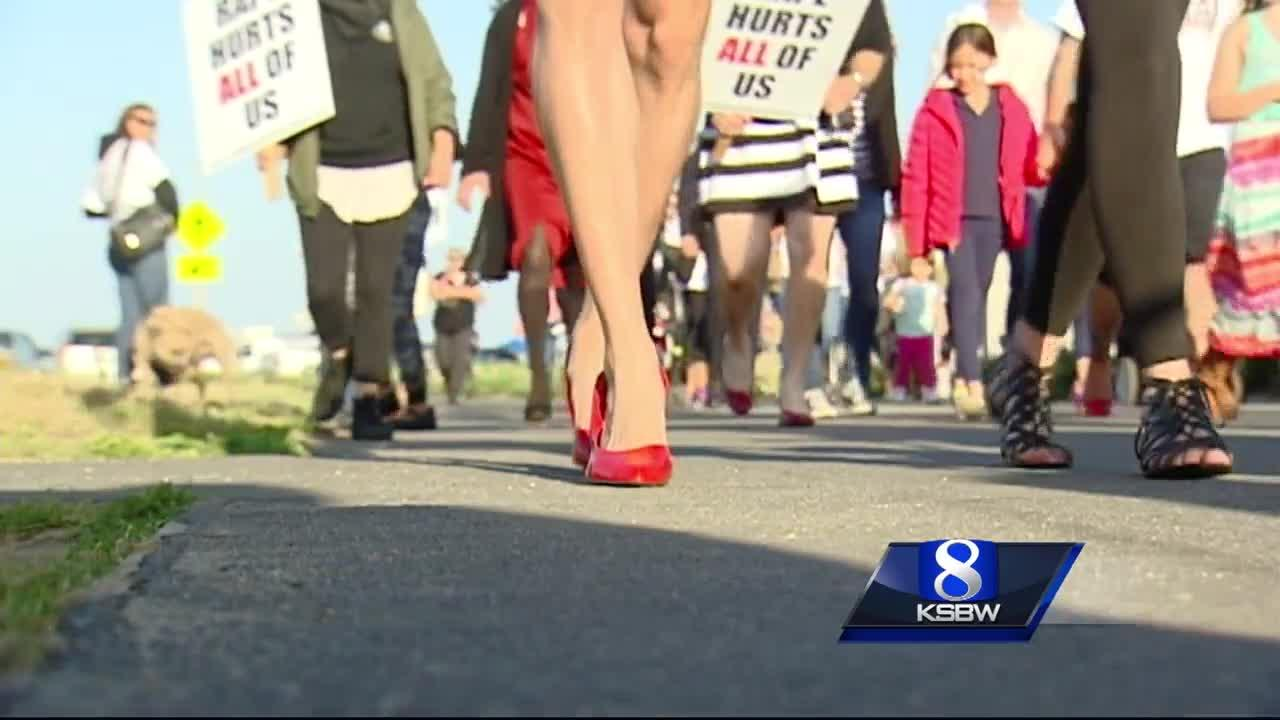 Dozens of men walk a mile in heels for sexual abuse victims