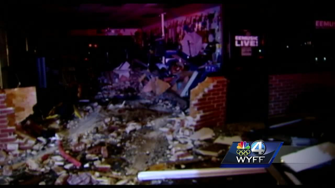 Driver drops phone, hits gas pedal, crashes into building, official says