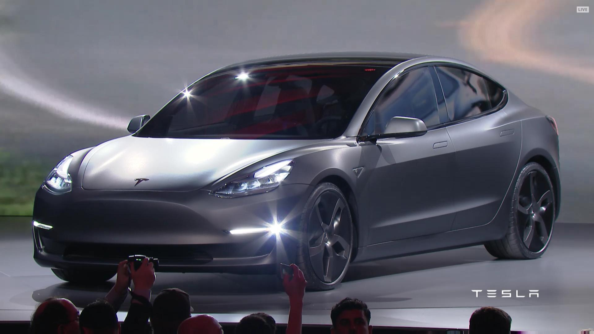 Tesla's affordable Model 3 overwhelms expectations
