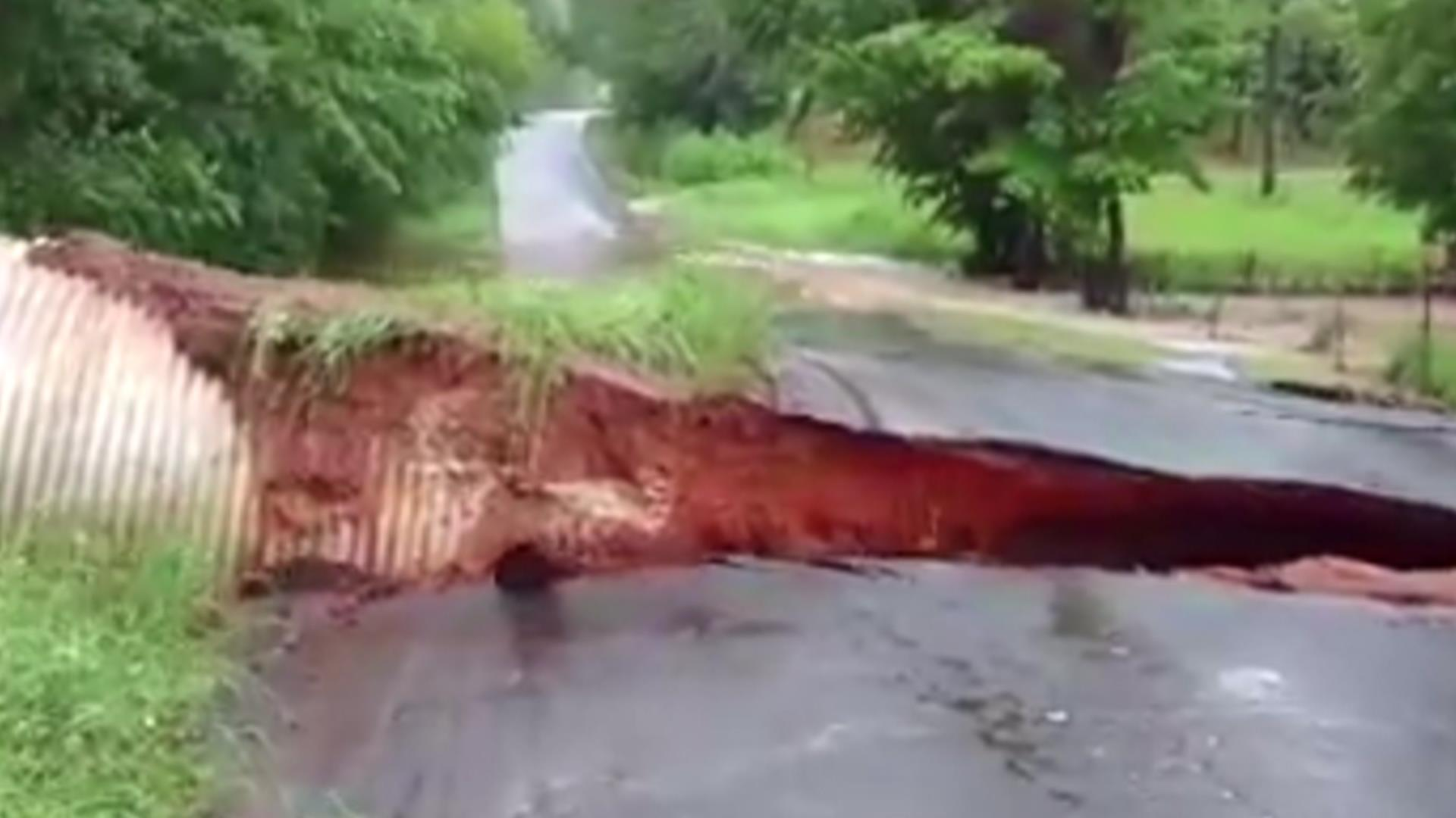 Watch Heavy Rains Wash Away Texas Roadway