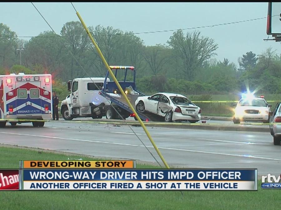 Wrong way driver hits IMPD officer