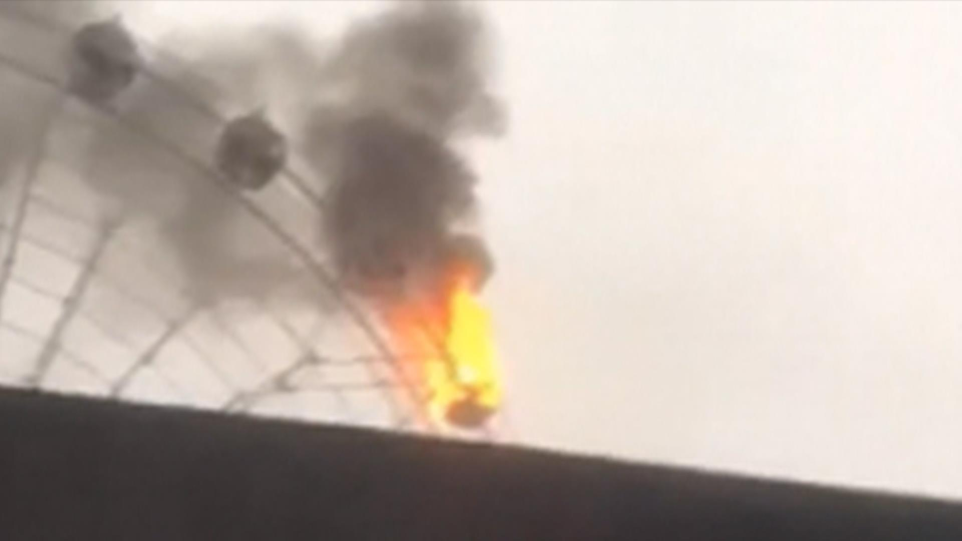 See Fire Engulf Part of Giant Ferris Wheel