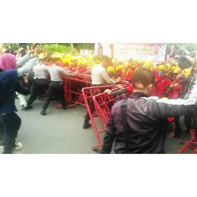 May Day Protesters Push Against Police Barricades in Jakarta