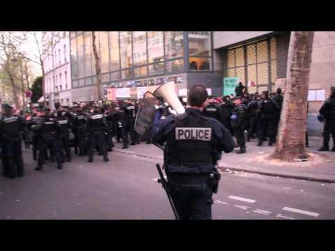 Police Attempt to Remove Migrants Occupying School Building in Paris