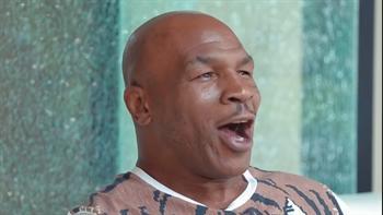 Watch Mike Tyson inexplicably rap alongside a puppet