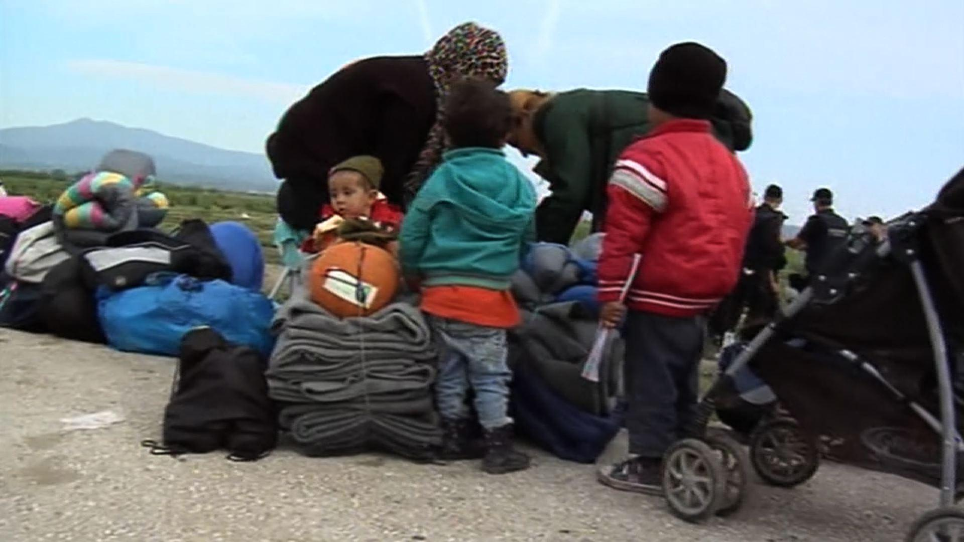 Raw: Greece Begins Evacuating Refugee Camp