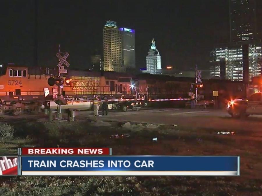 Vehicle struck by train after becoming stuck on tracks; no major injuries