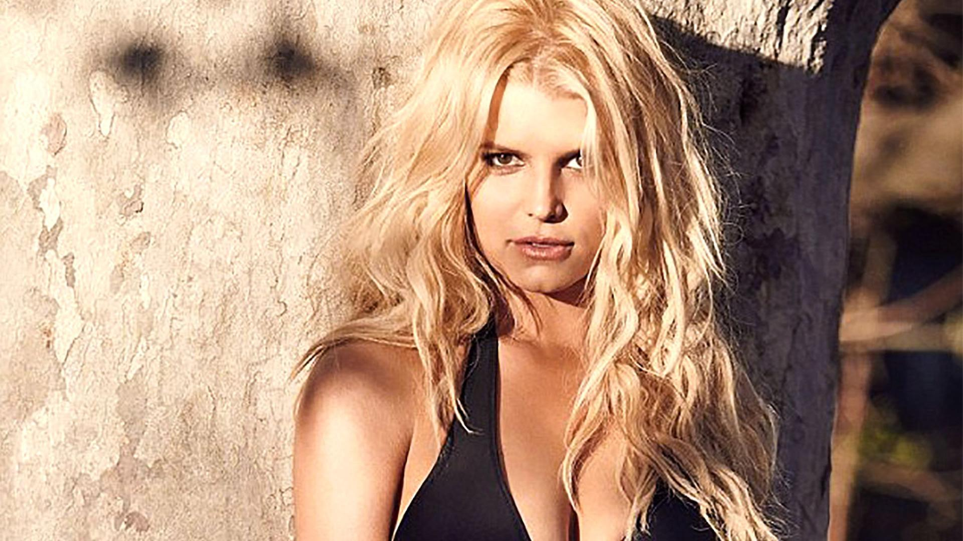 Jessica Simpson Looks HOT Modeling Her Own Swimsuit Collection