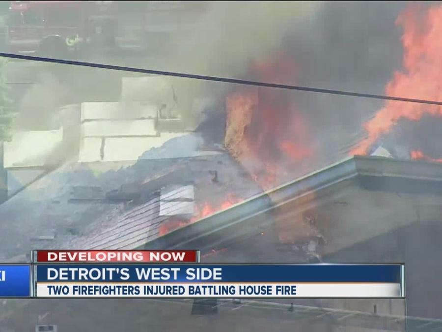 Firefighters injured battling fire