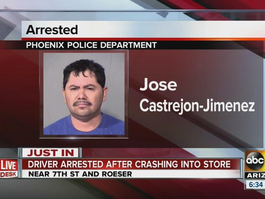 Driver arrested after crashing into store