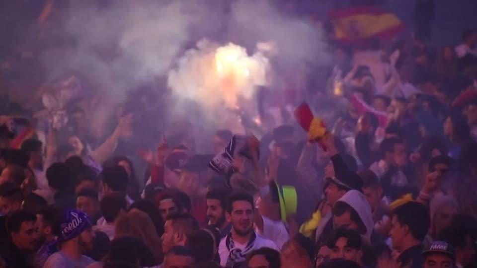 Real Madrid show off the Champions League trophy in the Cibeles Square