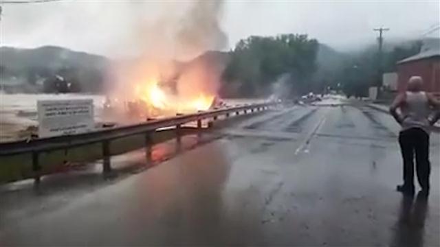 West Virginia Floods: Burning Building Swept Away