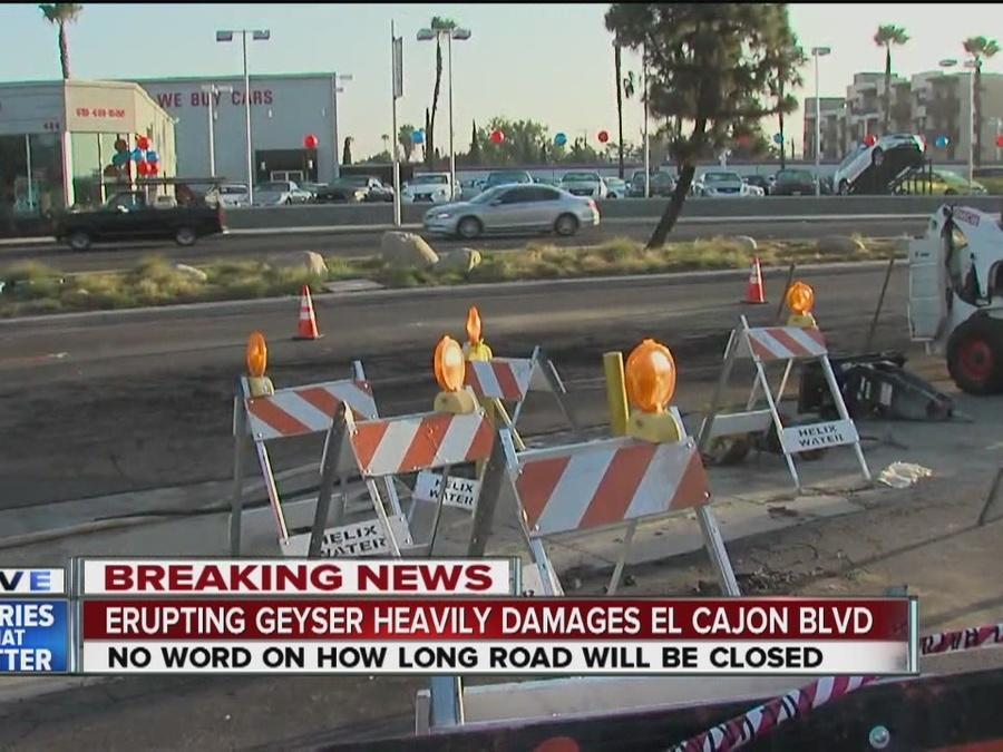 U-Haul truck sheers hydrant, geyser buckles road
