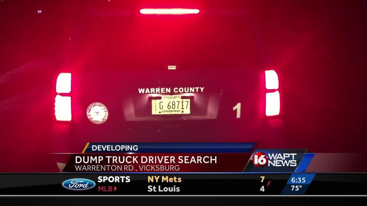 Search resumes for driver of sunken dump truck