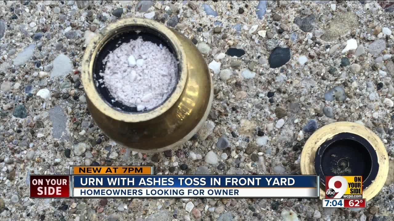 Urn with ashes tossed in front yard