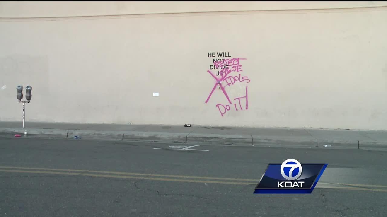 """He will not divide us"" exhibit vandalized"