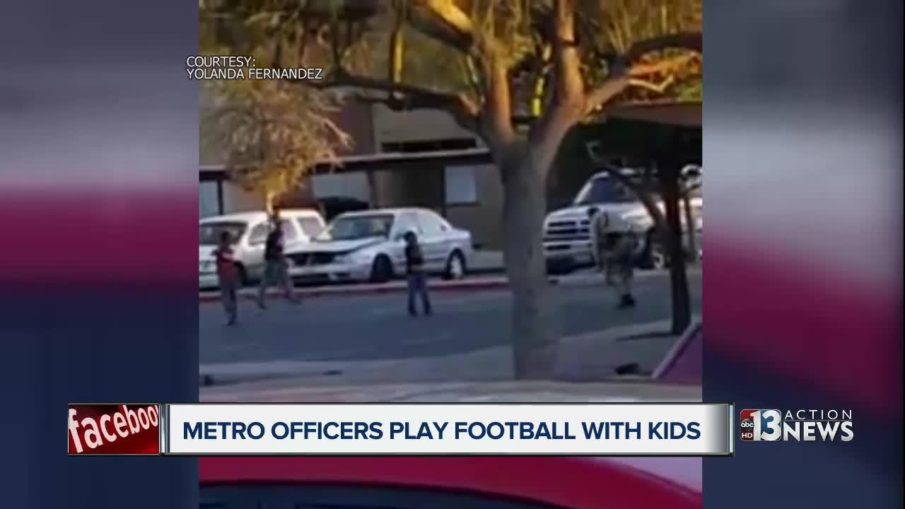 Woman pleasantly surprised to see officers playing football with kids