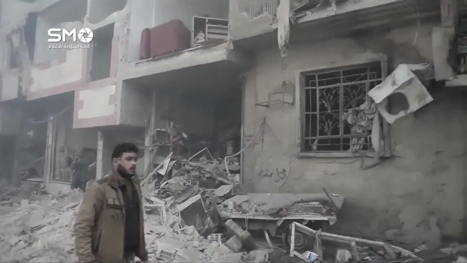 Syrians rescued from rubble following Douma air strike - social media video