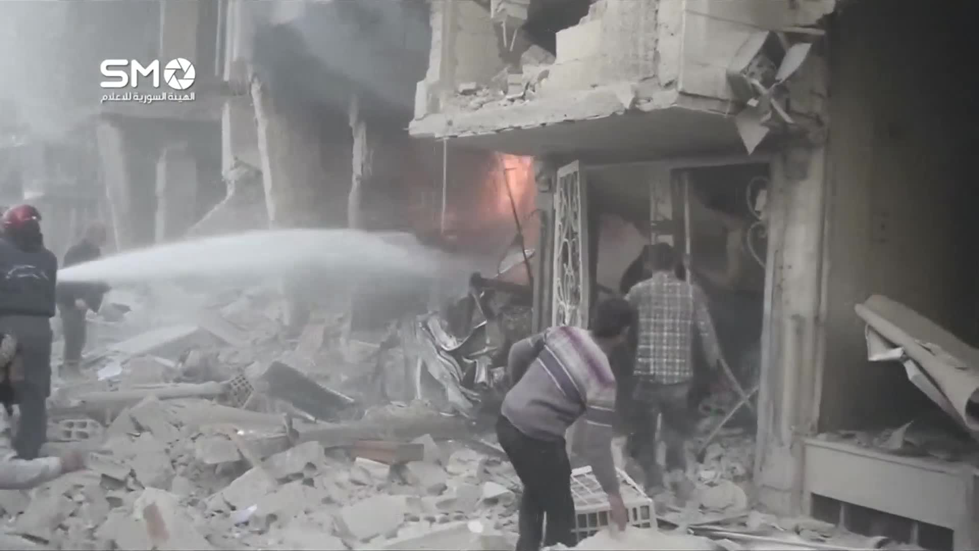 Syrians rescued from rubble following Douma air strikes - social media video