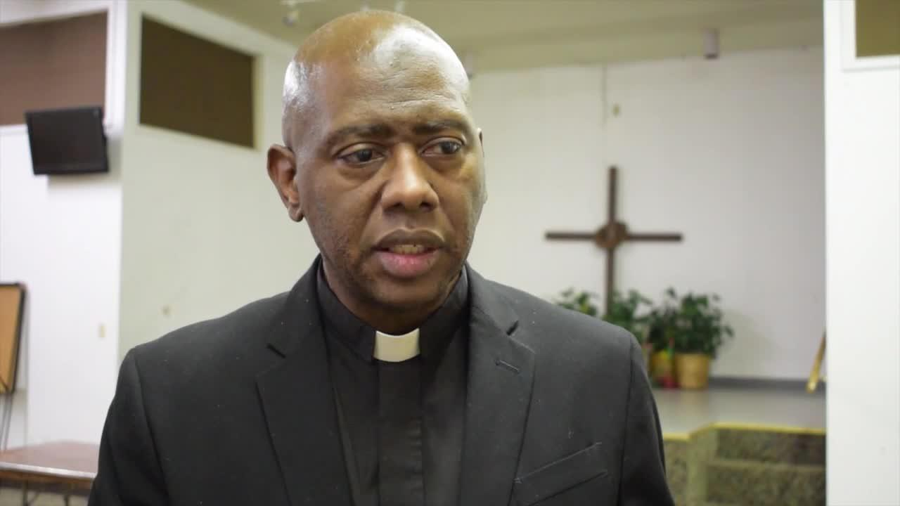 """Rev. Charles Harrison says unsolved quadruple homicide has neighborhood feeling forgotten. """"The view out here is that lives in these kind of neighborhoods really don't matter."""""""