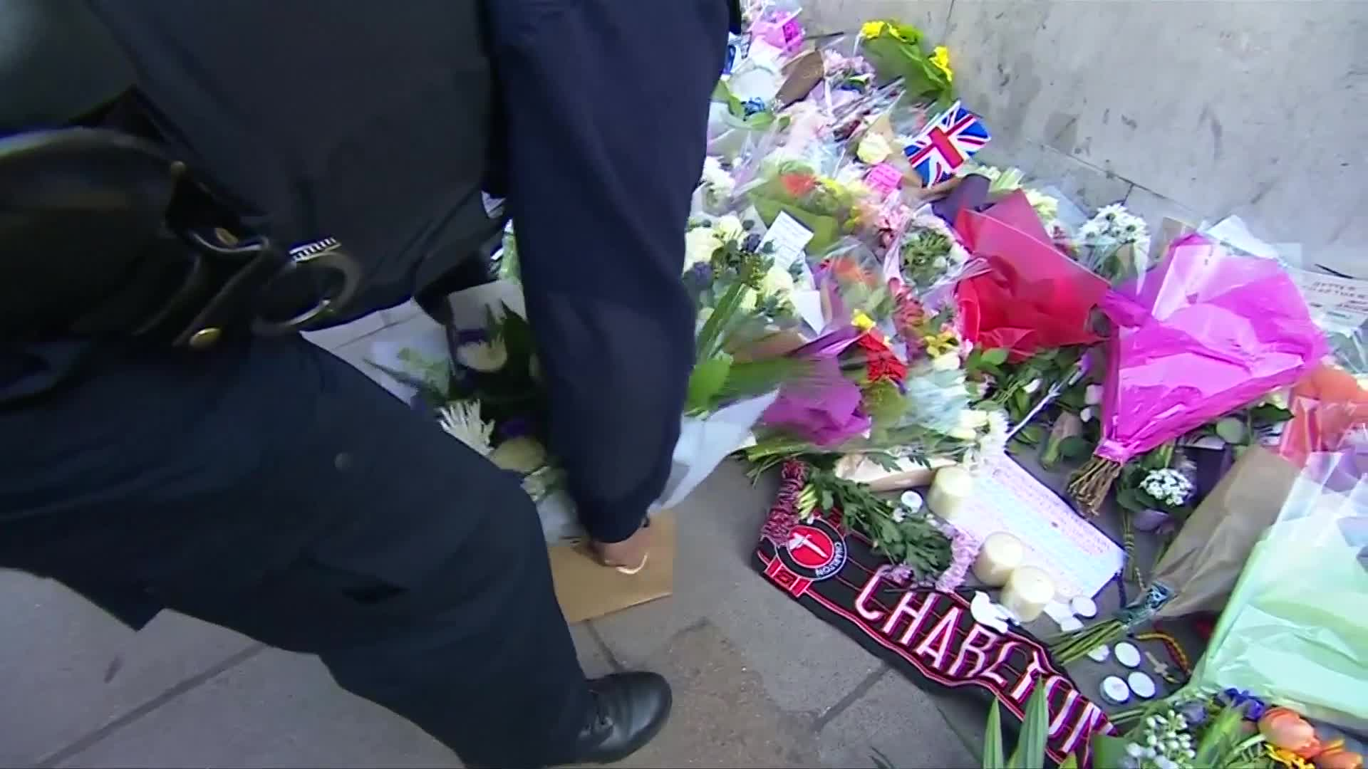 London police officers lay flowers in tribute to PC Palmer