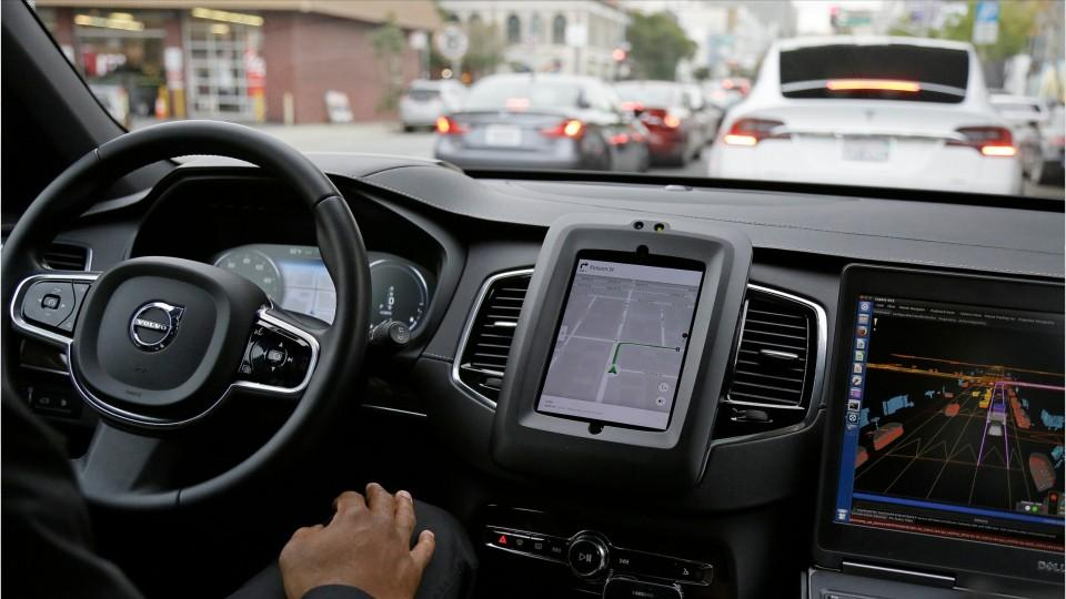 Uber crash causes firm to pause self-driving car program - CNET