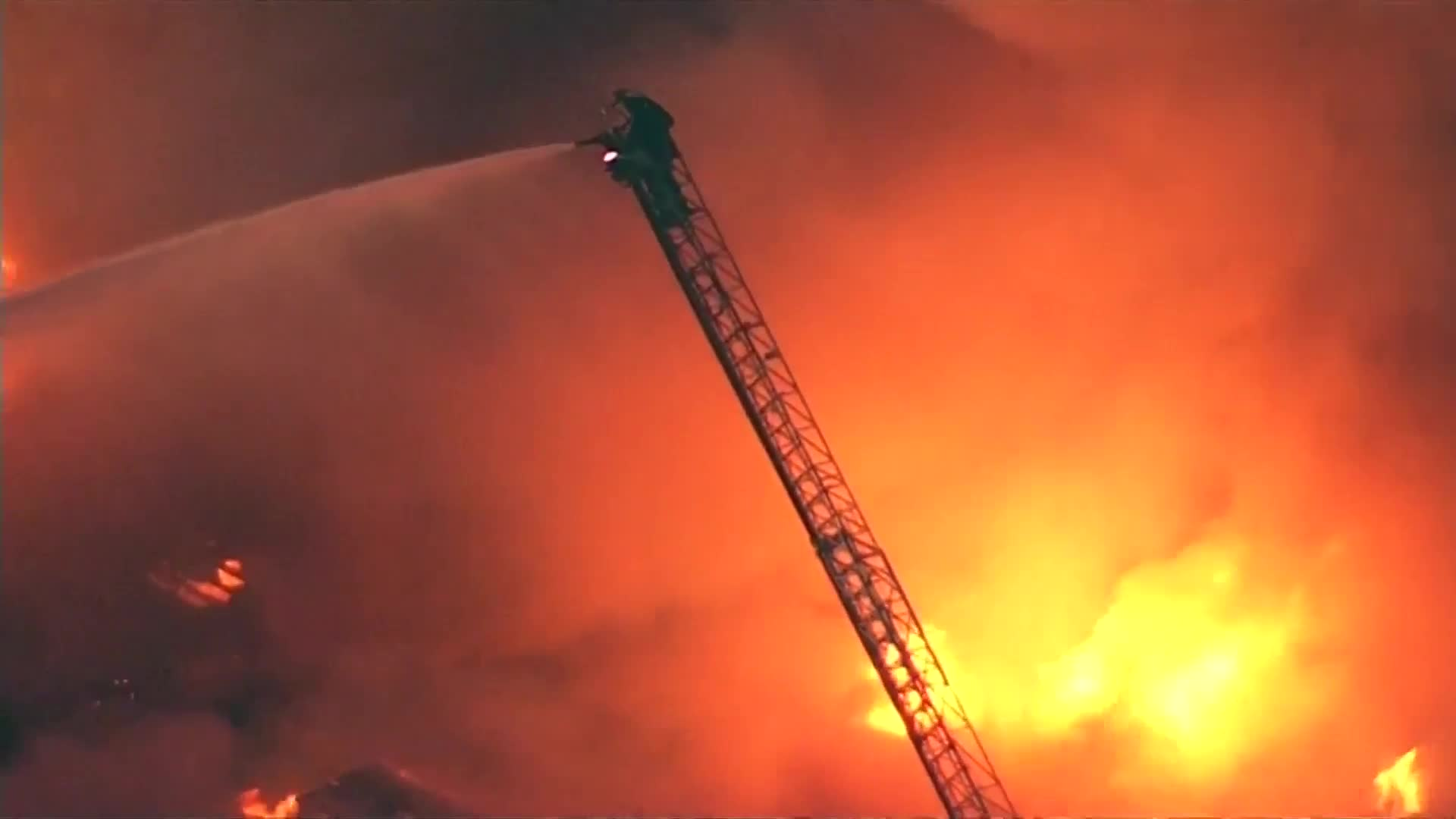 Huge fire rips through Oakland apartment building, rescues underway