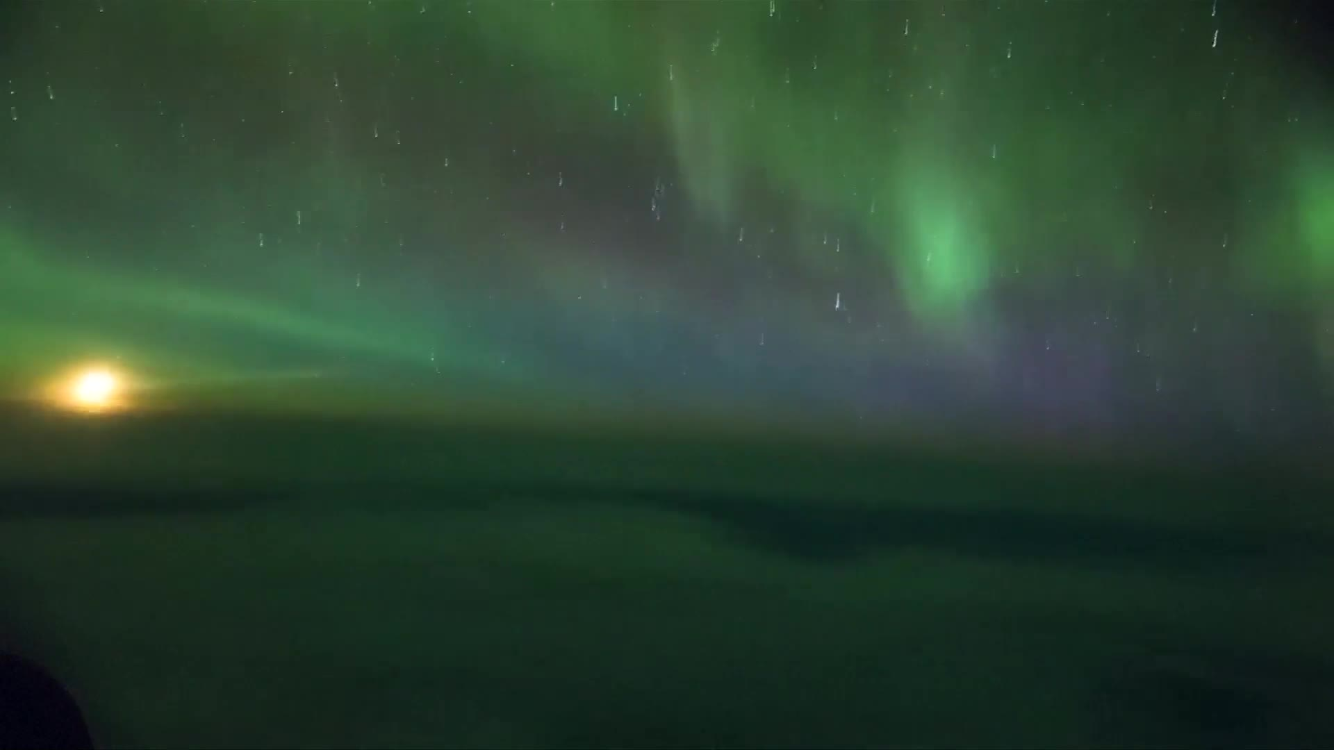 Time-lapse of Aurora Australis captured from inside airplane cabin
