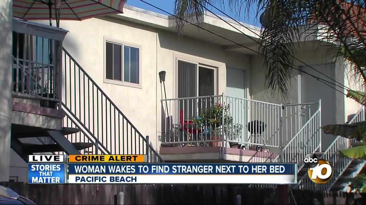 Woman wakes to find intruder over her bed