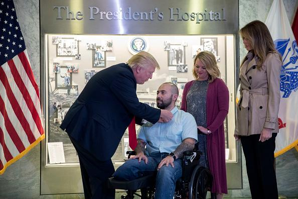 Trump awards Purple Heart to wounded soldier