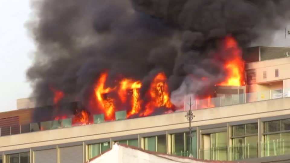 Fire rages on top of Madrid hotel
