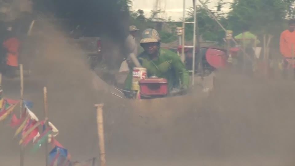Muddy drama in Thai tractor race