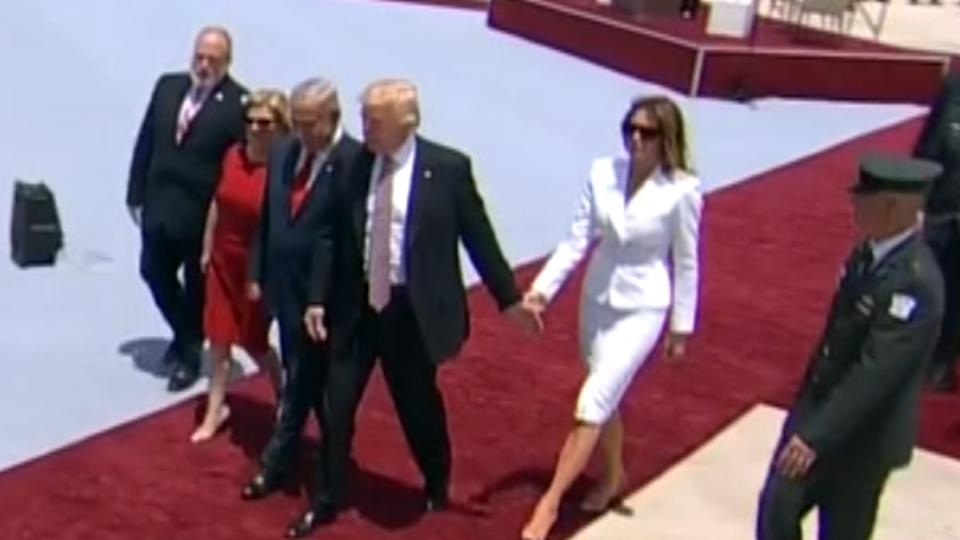 Did the U.S. First Lady flick away her husband's hand during Israel visit?