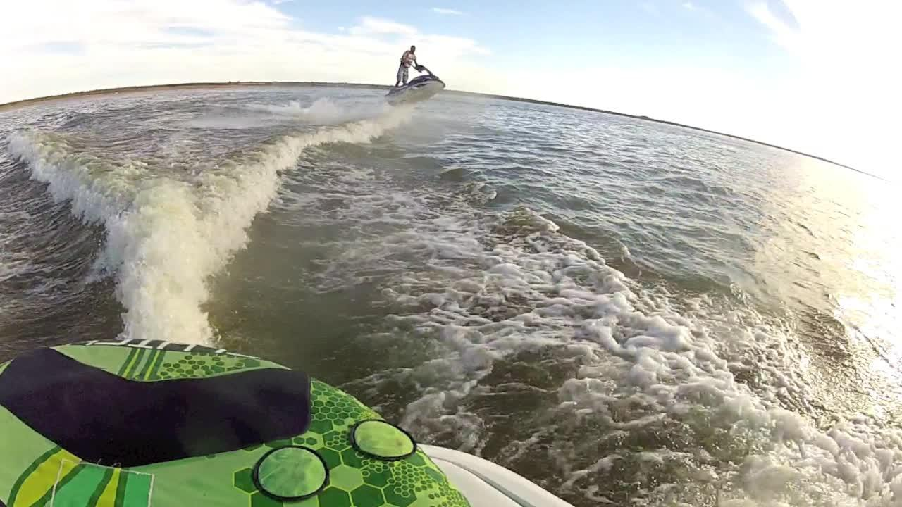 Epic Fail! Gnarly Jet Ski Crash Off a Boat Wake
