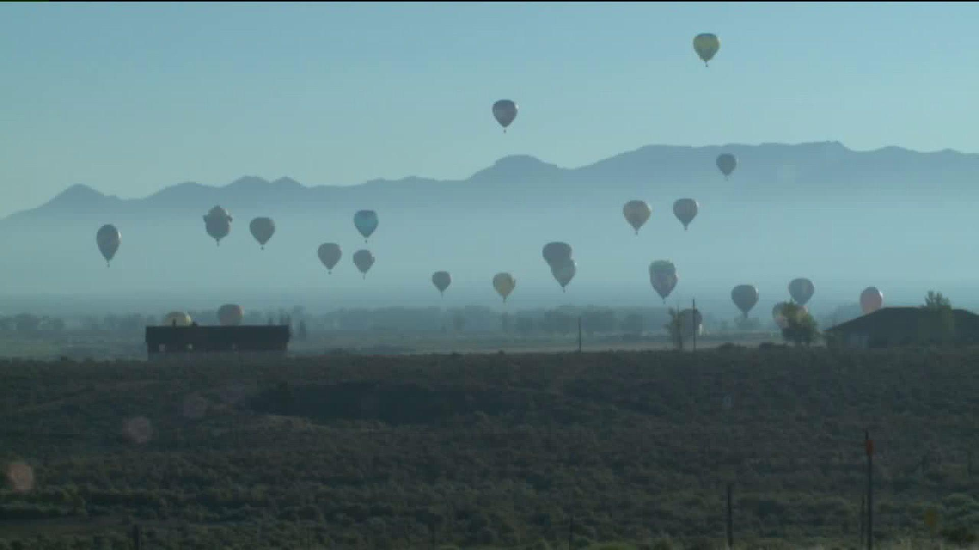 Hot Air Balloons Take Flight as Massive Wildfire Grows at 'Unprecedented' Pace