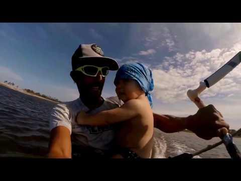 Guy Kite Surfs With One Year Old