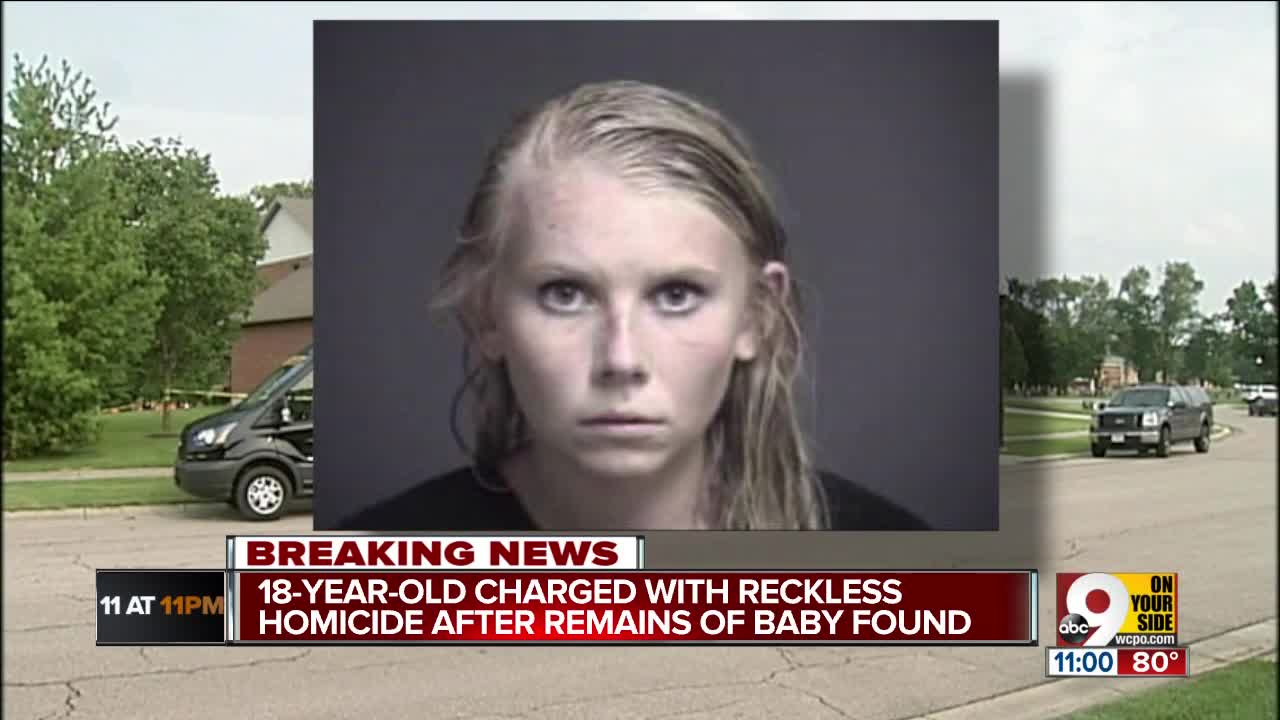 Woman charged with homicide over infant remains