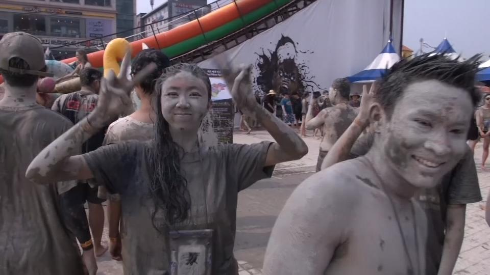 Revellers party in South Korea's capital of mud