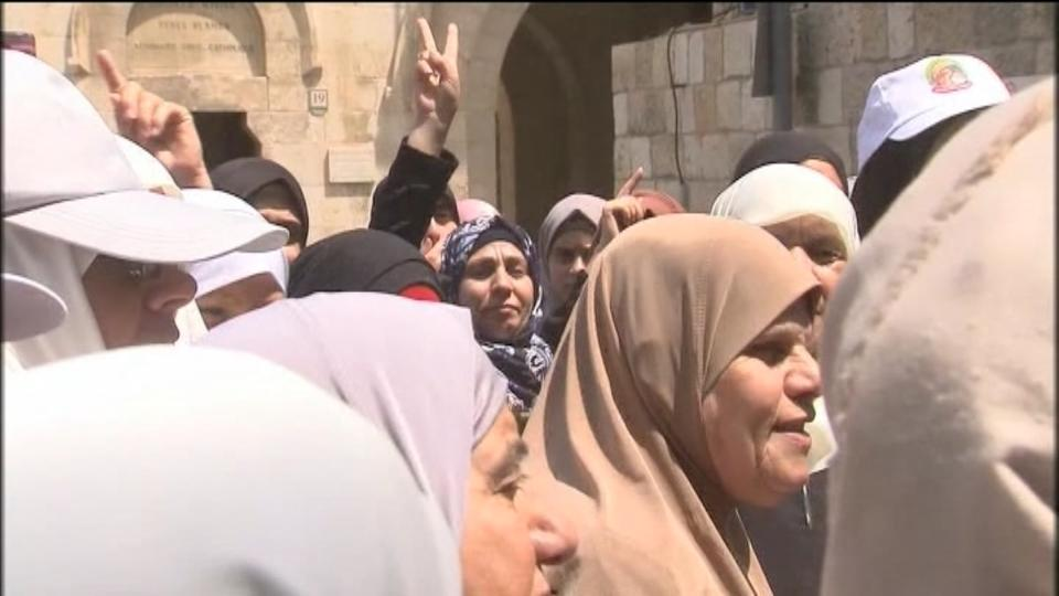Palestinians celebrate near Al-Aqsa after Israel backs down