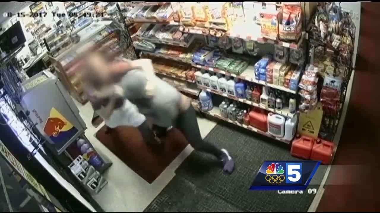 Facing armed robber, store clerk fights back