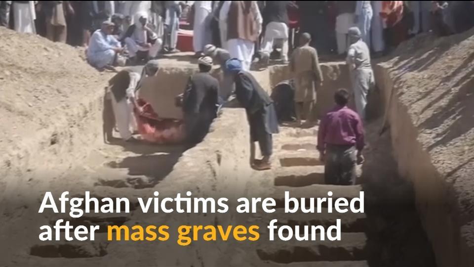 Afghans bury relatives after police find mass graves