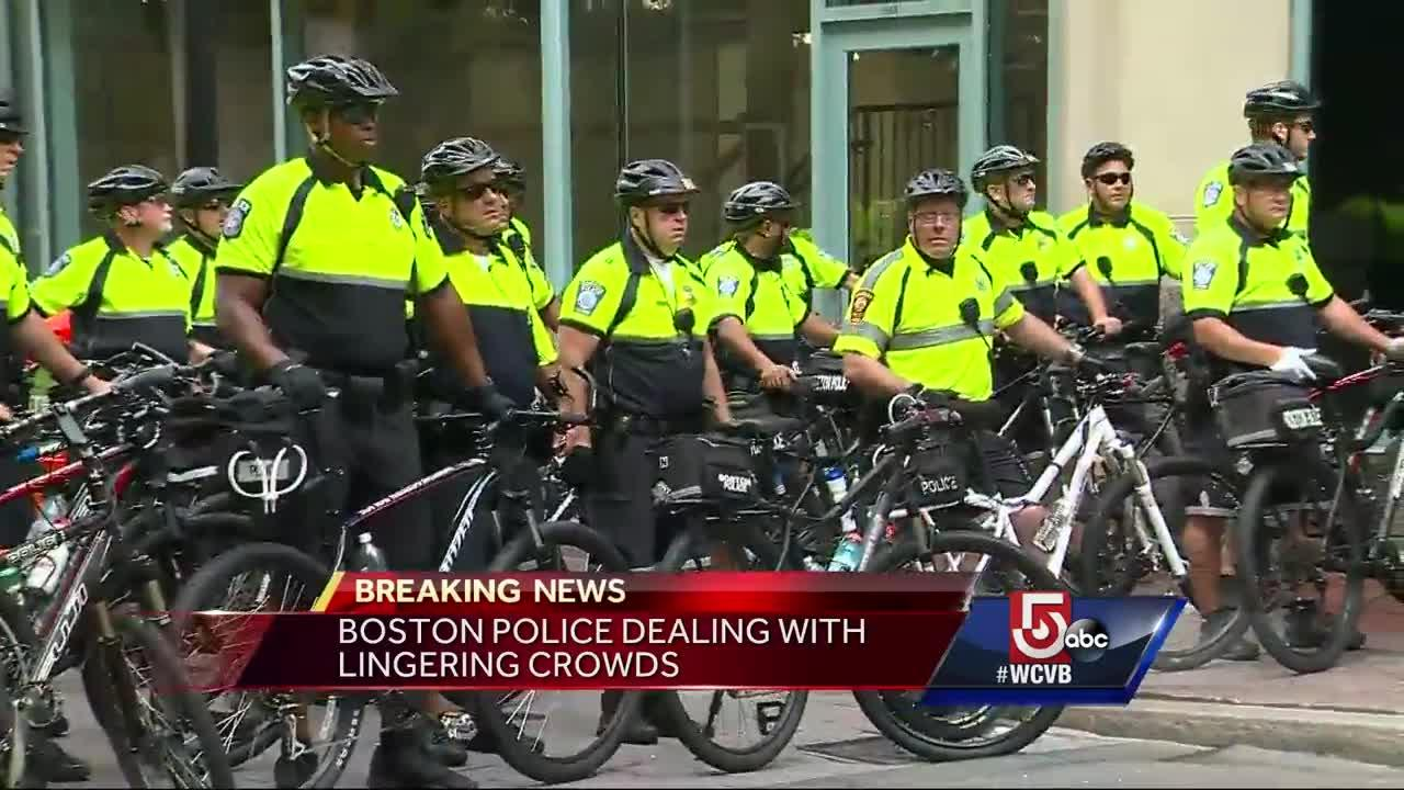 Confrontations with protesters, police in Downtown Crossing; objects thrown