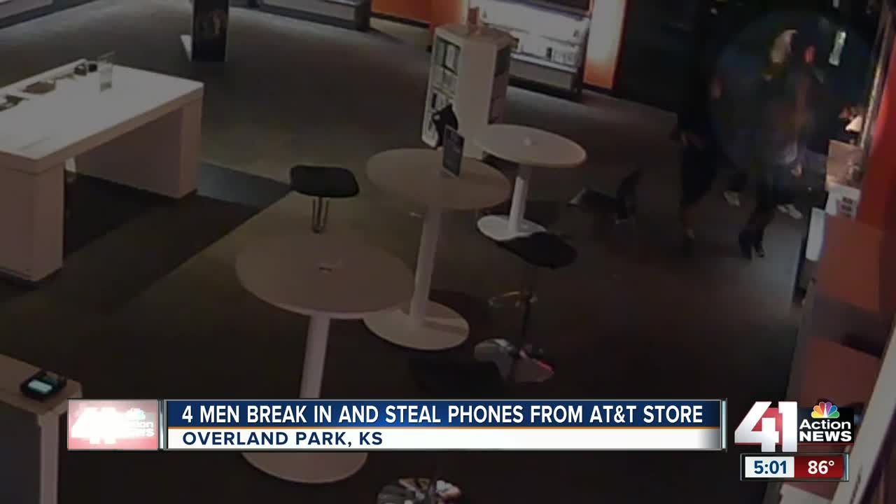 Video captures suspects busting through AT&T cell phone store, grabbing devices.