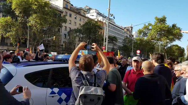 Protesters Block Police Car as Catalan Official Arrested During Raid