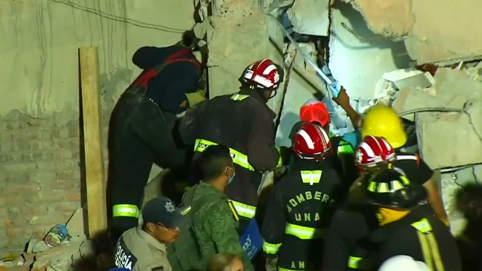 Rescuers dig through collapsed buildings after Mexico quake