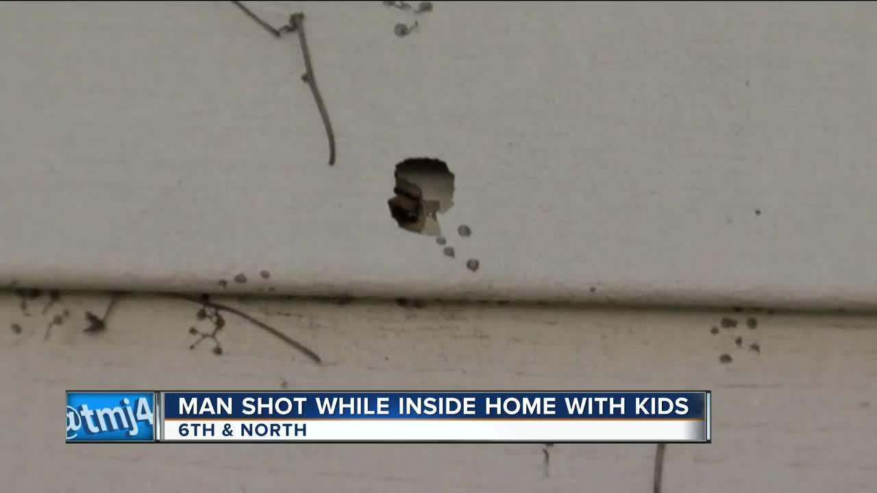 Stray bullet hits man feeding baby in home during shootout