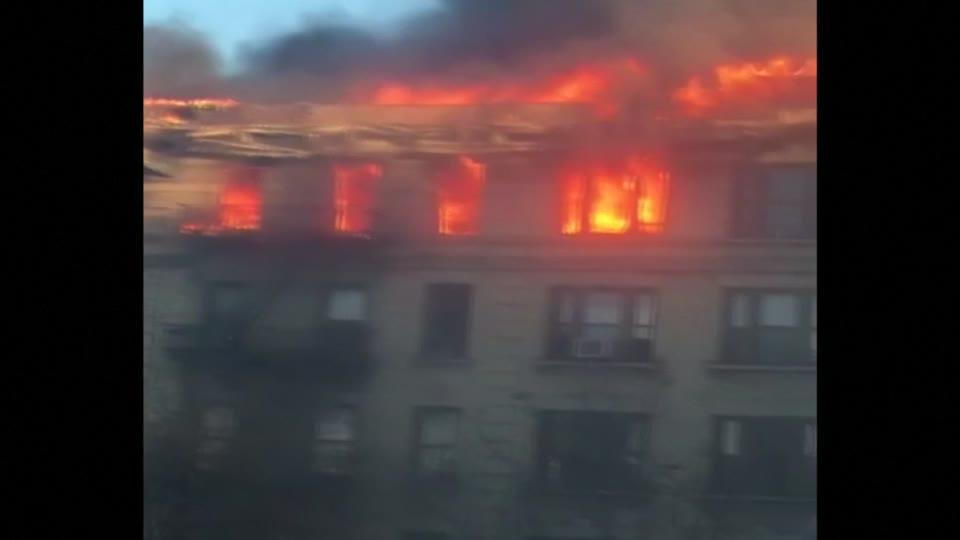 Fire burns through top floor of Manhattan apartment building